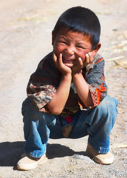 Funny face.  Little boy in Tibetan village