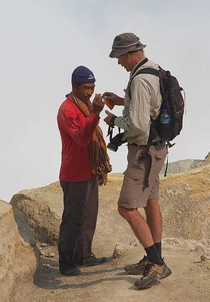 Sharing a cigarette.  All the miners in Ijen smoke.  Why not?  It probably does them less harm than the volcano.