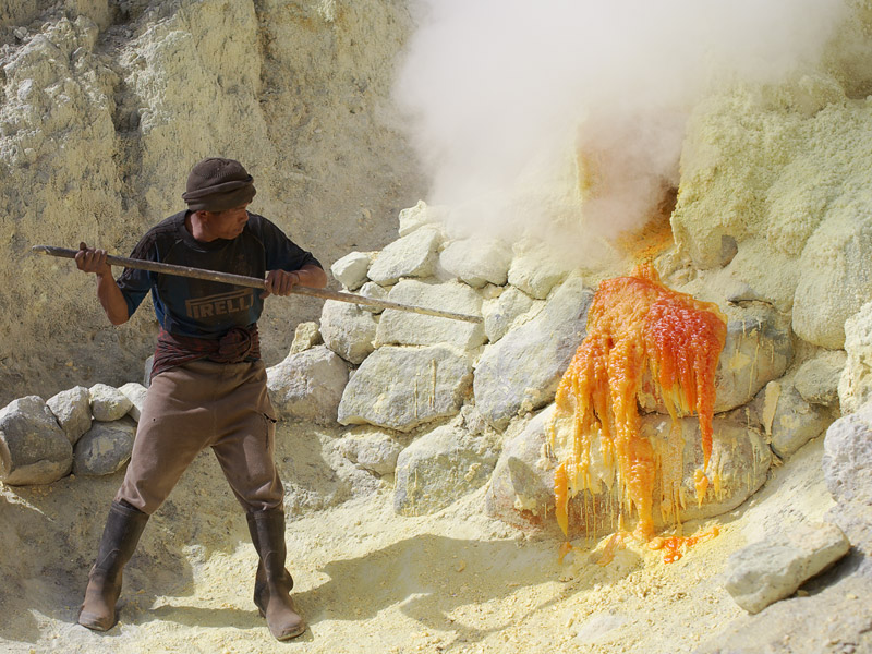 Woking in the kitchen.  A miner breaks off solid stalagtites of sulfur.
